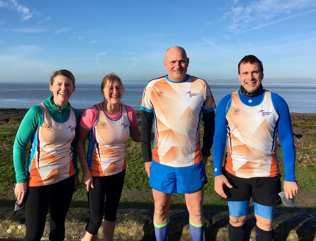 four runners raising money for Alzheimer's Research UK